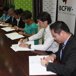 Six people signing MOU documents