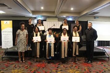 Cohort 14 graduates flanked by WINGS Rep Gou Kere, BCFW Executive Director Evonne Kennedy, Abt Associates rep Joy Waffi & PNGAA rep Kinivanagi Karo.