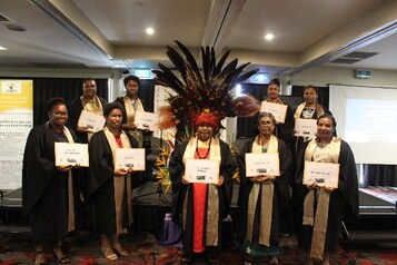 Cohort 11 graduates pose for a group photo