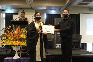 Elizabeth Asigau receiving her certificate