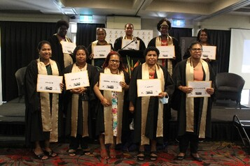 Cohort 13 graduates display their Australian accredited certificates